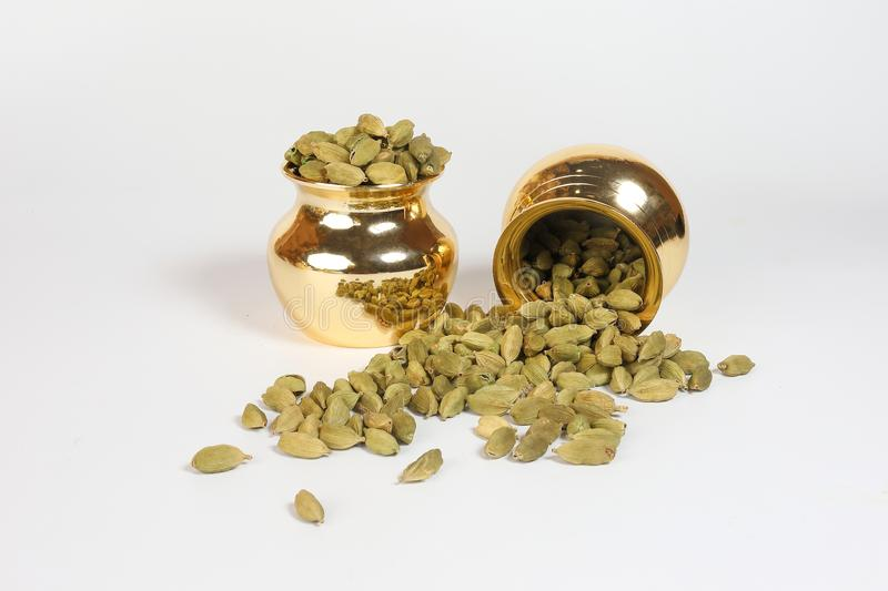 Cardamom spice in shiny metal pot royalty free stock images