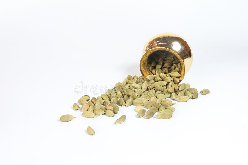 Cardamom spice in shiny metal pot stock photo