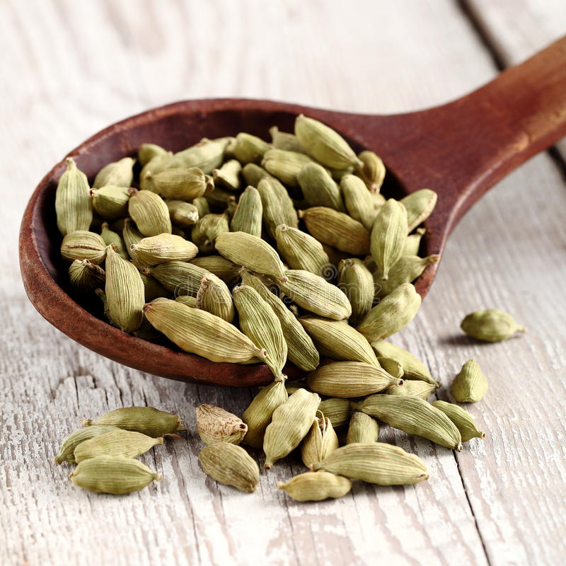 Cardamom. Spices on a wooden background royalty free stock photography