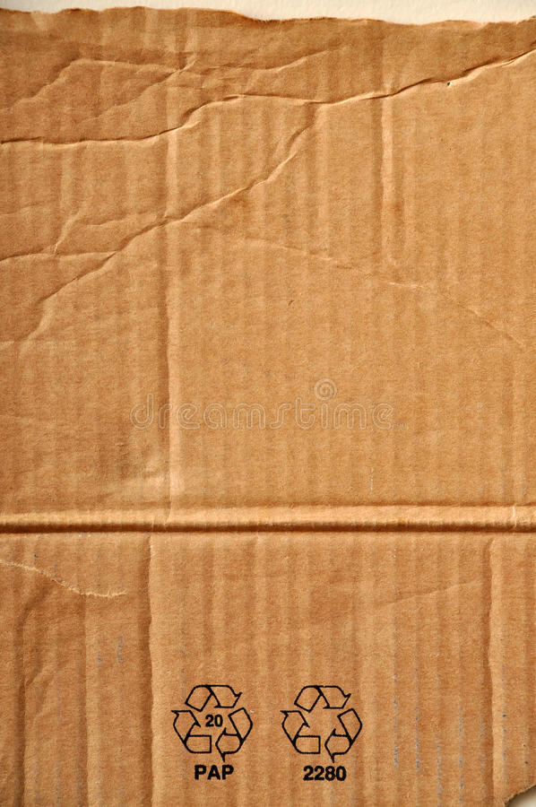 Cardboard. Torn section of a corrugated carton stock images