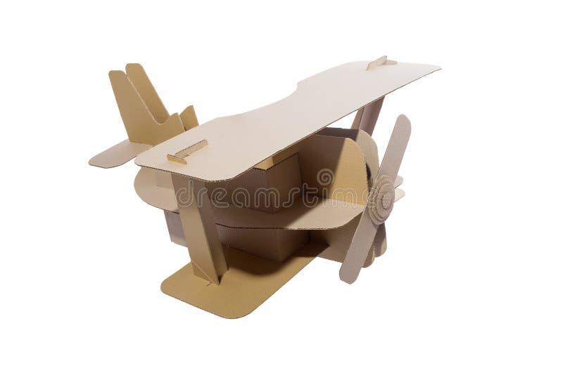 Cardboard biplane. Photo of cardboard plane on white background. Biplane stock images