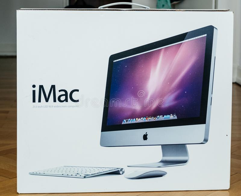 Cardboard box of Apple iMac computers unboxing. London, United Kingdom - Mar 31, 2014: Cardboard box unboxing of new iMac 21,5 personal computer made by Apple stock images