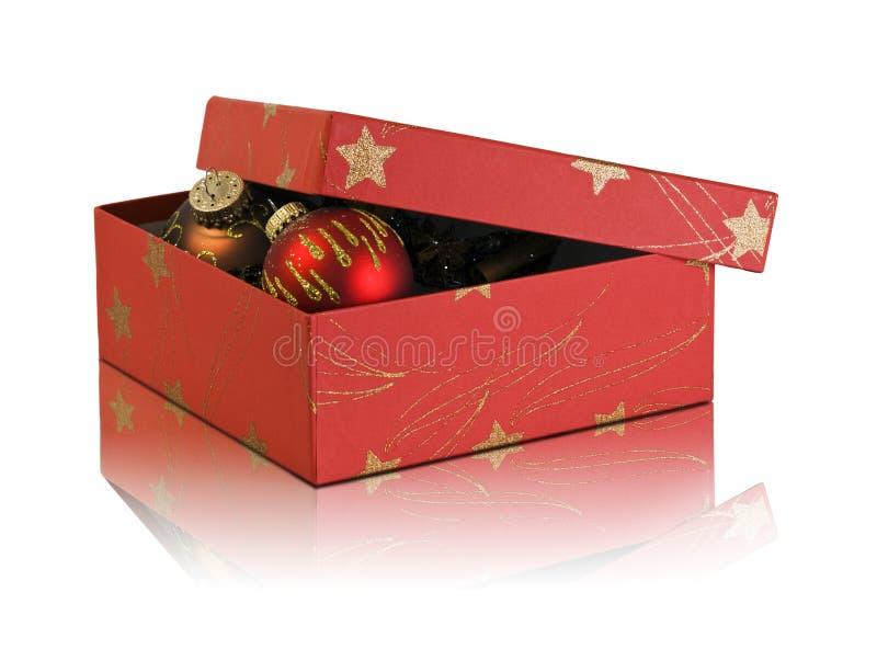 Cardboard box with christmas decoration royalty free stock photos