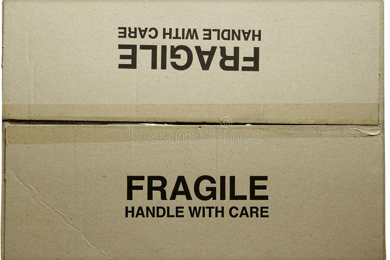 Cardboard box. Closeup of fragile words on cardboard box stock photo