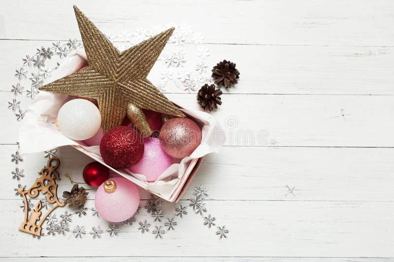 Cardboard box filled with shiny Christmas decorations stock photos
