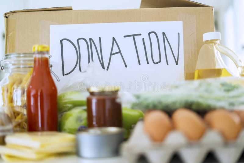 Cardboard box with food donation stock images