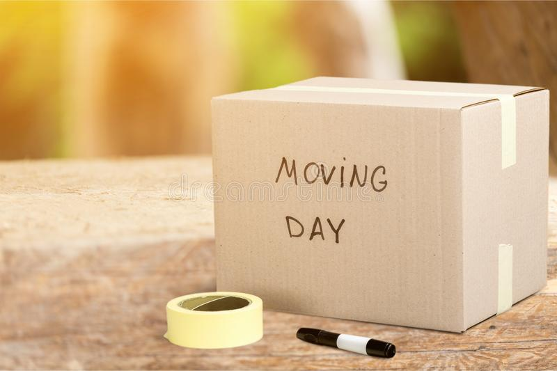 Cardboard Box labelled moving day. Box day cardboard moving cardboard box moving day white royalty free stock image