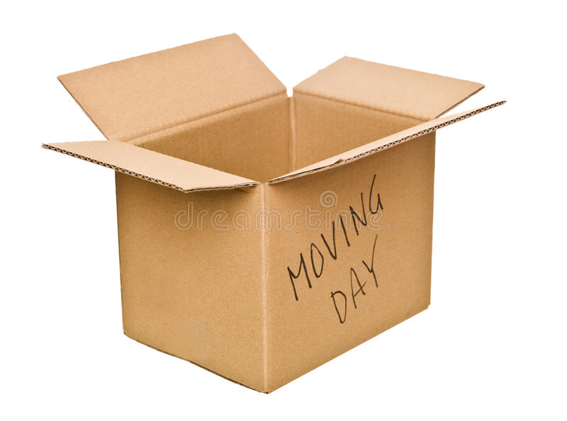 Cardboard box marked Moving Day royalty free stock photos