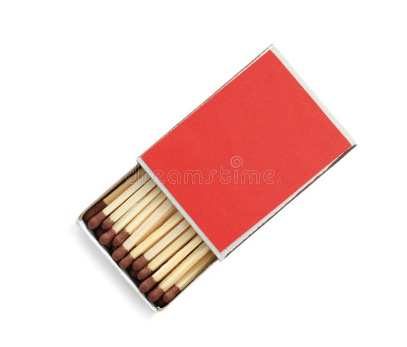 Cardboard box with matches on white, top view. Space for design royalty free stock images