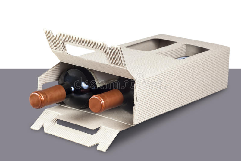 Cardboard box with wine bottles royalty free stock photography