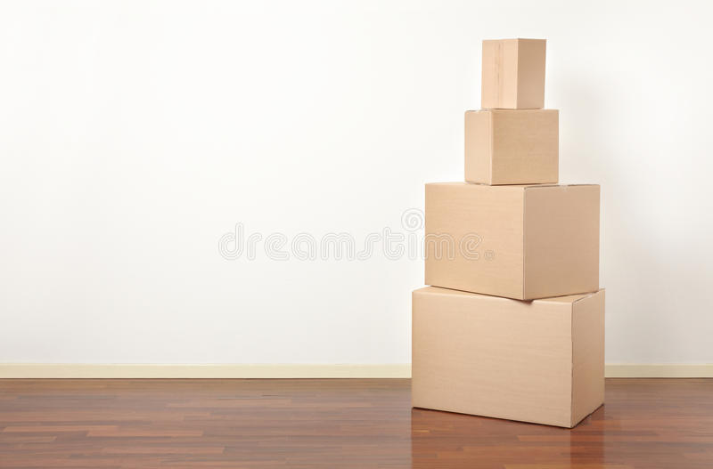 Cardboard boxes stack in apartment, moving day stock photography
