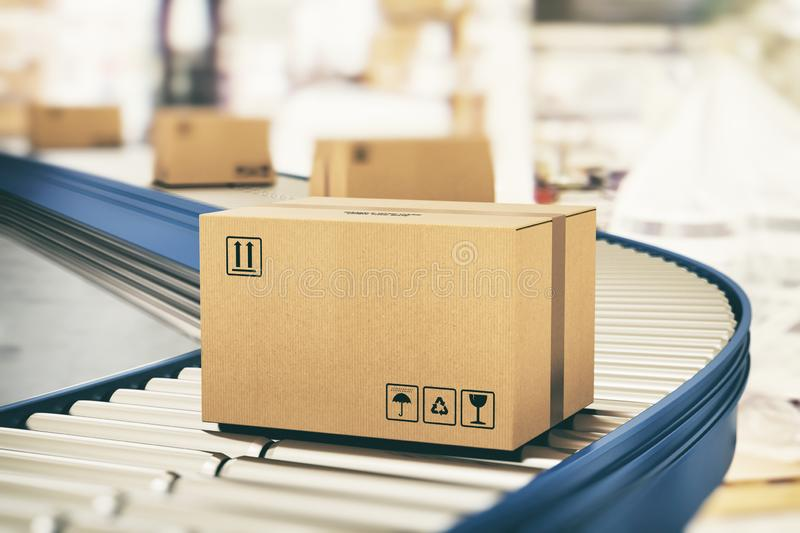 Cardboard boxes on conveyor rollers ready to be shipped by courier for distribution royalty free stock photos