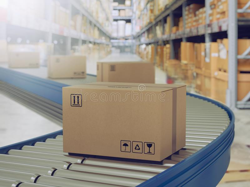 Cardboard boxes on conveyor rollers ready to be shipped by courier for distribution. royalty free stock image