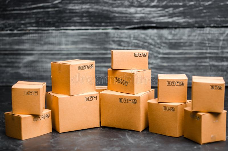 Cardboard boxes on a dark background. The concept of packing goods, sending orders to customers. Warehouse of finished products. And equipment. Moving to royalty free stock images