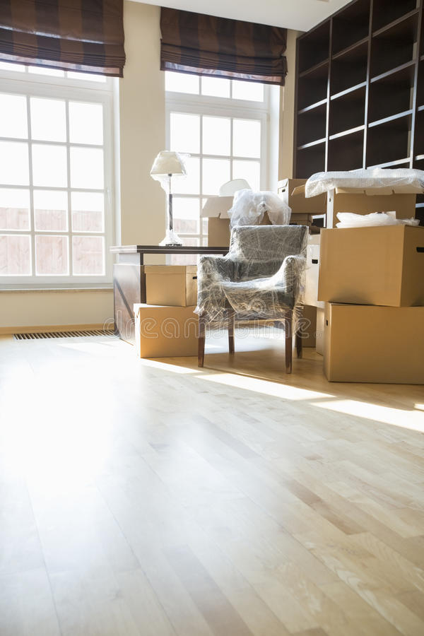 Cardboard boxes and furniture in new home stock photo