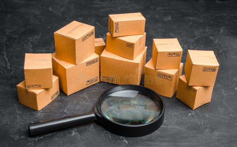 Cardboard boxes and glass on a dark background. The concept of packing goods, sending orders to customers. Warehouse of finished. Products and equipment. Moving stock images