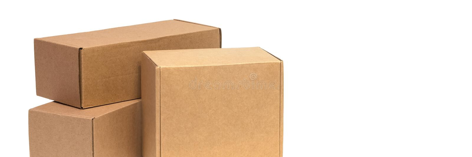 Cardboard boxes for goods on a white background. Different size. Isolated on white background.  royalty free stock photo