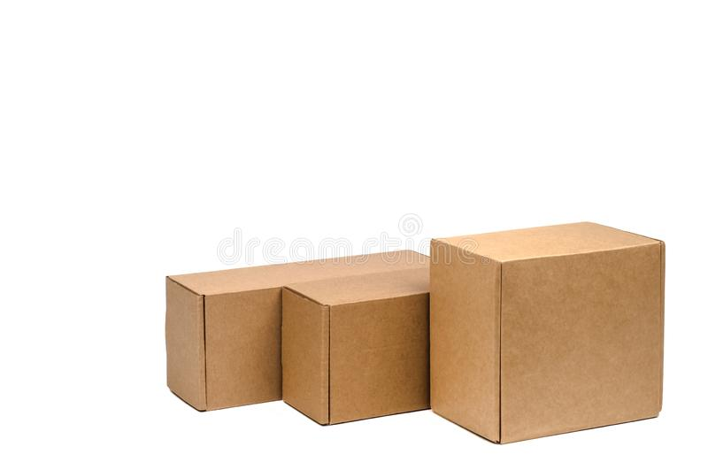 Cardboard boxes for goods on a white background. Different size. Isolated on white background.  royalty free stock images