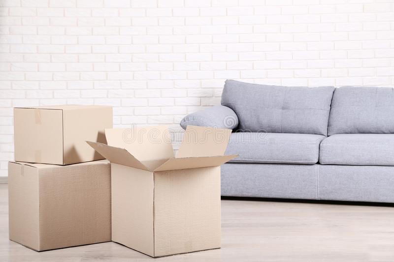 Cardboard boxes with sofa royalty free stock image