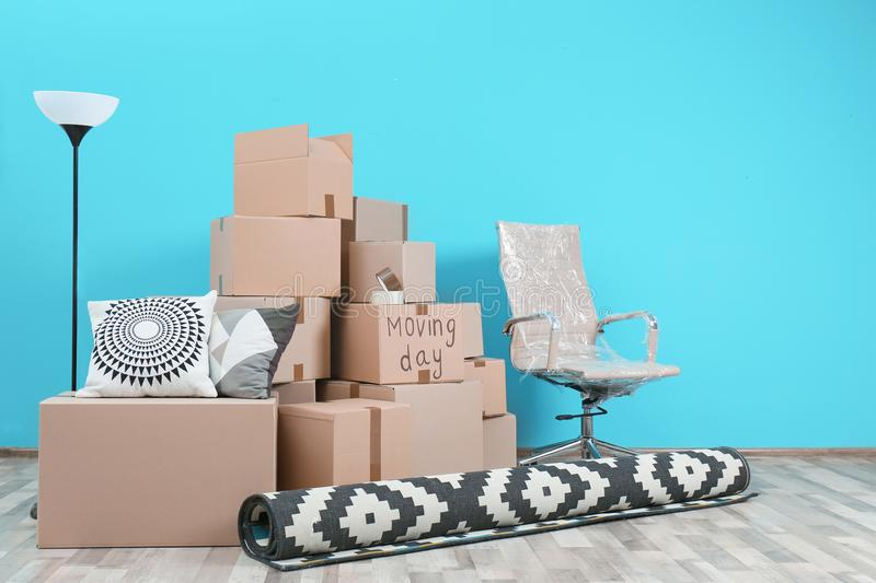 Cardboard boxes and household stuff in empty room royalty free stock photography