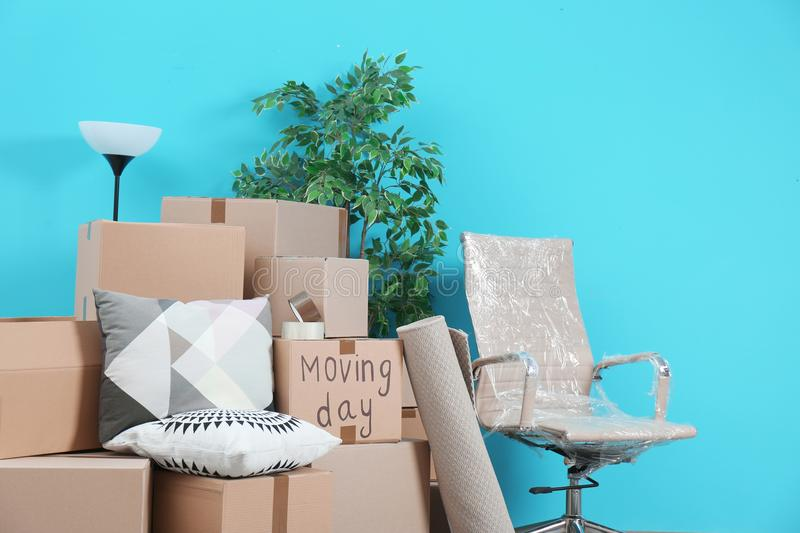 Cardboard boxes and household stuff in empty room stock image