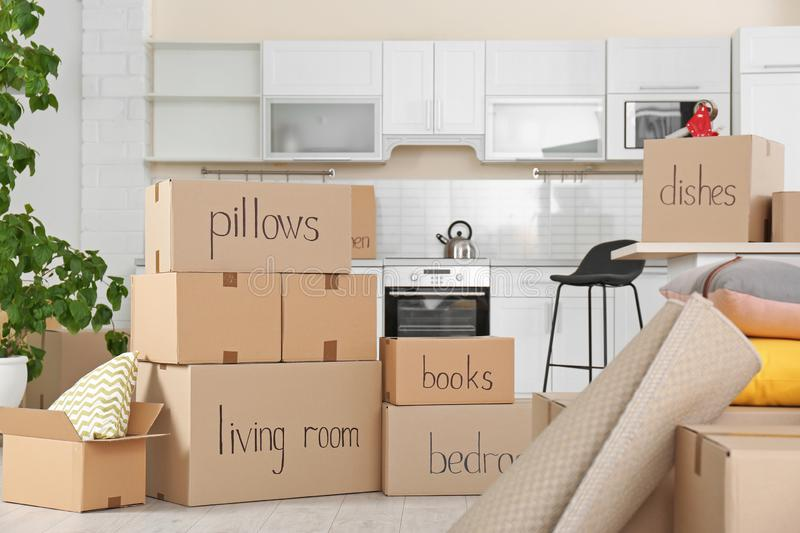 Cardboard boxes and household stuff in kitchen royalty free stock images