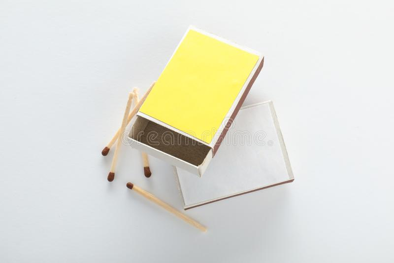 Cardboard boxes and matches on white background, top view. stock photos