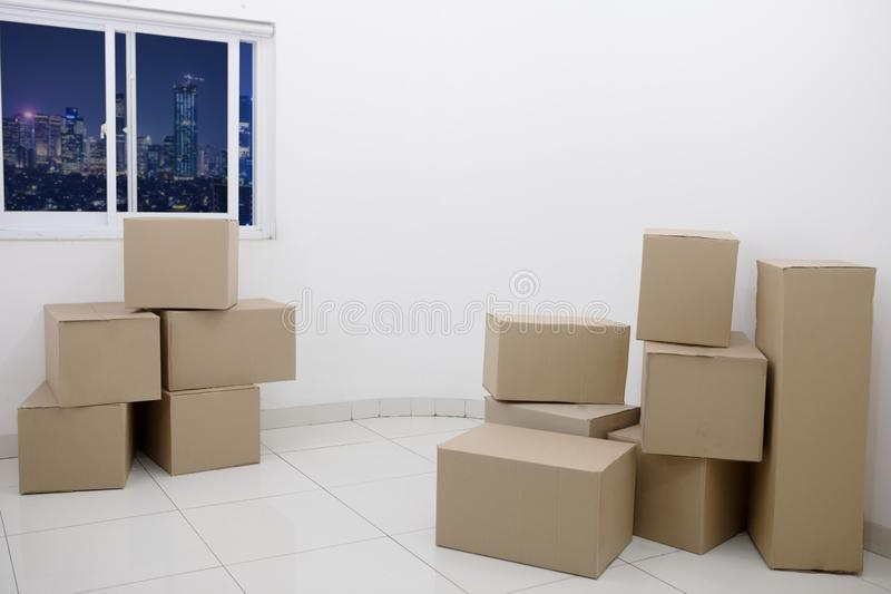 Cardboard boxes in a new apartment royalty free stock photos