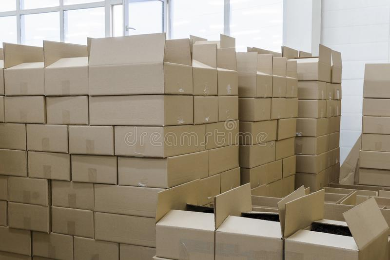 Cardboard boxes in the packaging workshop. Stacks of cardboard boxes with products in the packaging workshop stock image