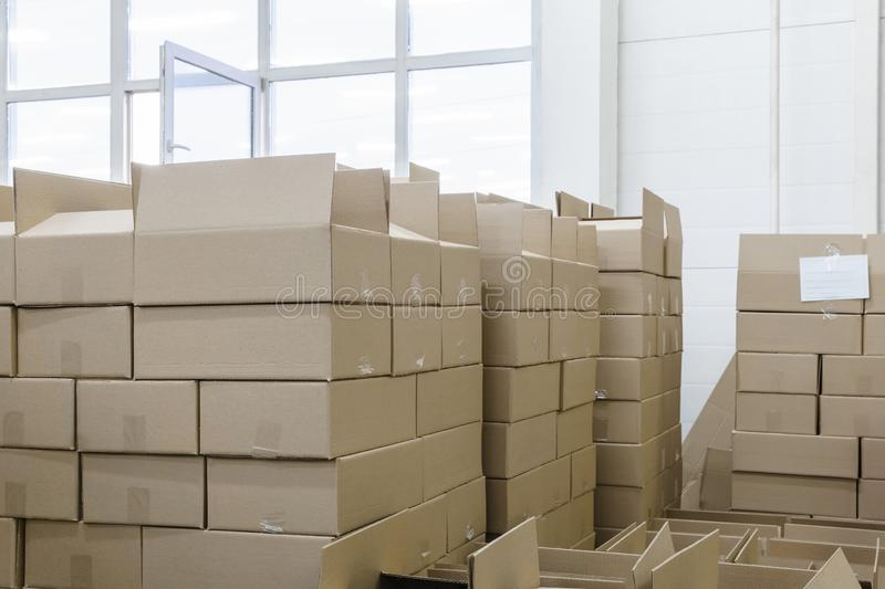 Cardboard boxes in the packaging workshop. Stacks of cardboard boxes with products in the packaging workshop royalty free stock images