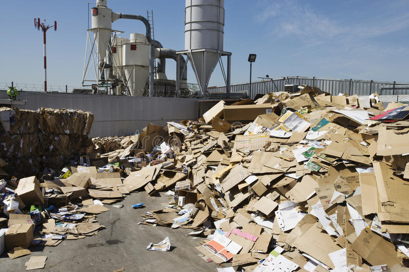 Cardboard Boxes In Recycling Centre. Pile of cardboard boxes in recycling center royalty free stock photo