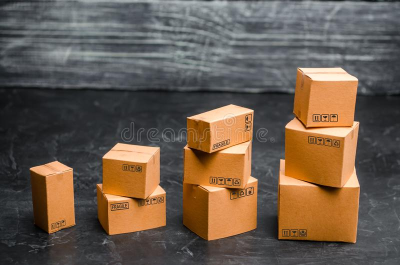 Cardboard boxes are stacked incrementally. The concept of packing goods, sending orders to customers. Sales growth stock images