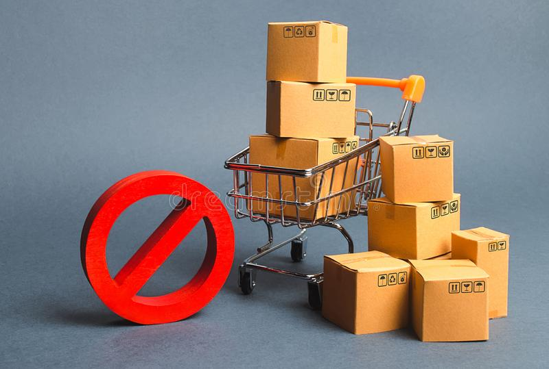 Cardboard boxes, supermarket trolley and red symbol NO. Embargo, trade wars. Restriction on the importation of goods, proprietary. For business. Inability to stock photography