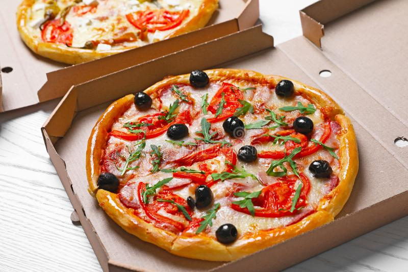 Cardboard boxes with tasty pizzas stock images