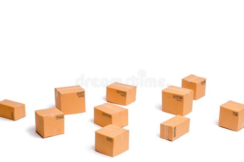 Cardboard boxes on a white background. The concept of packing goods, sending orders to customers. Warehouse of finished products. And equipment. Moving to stock photos