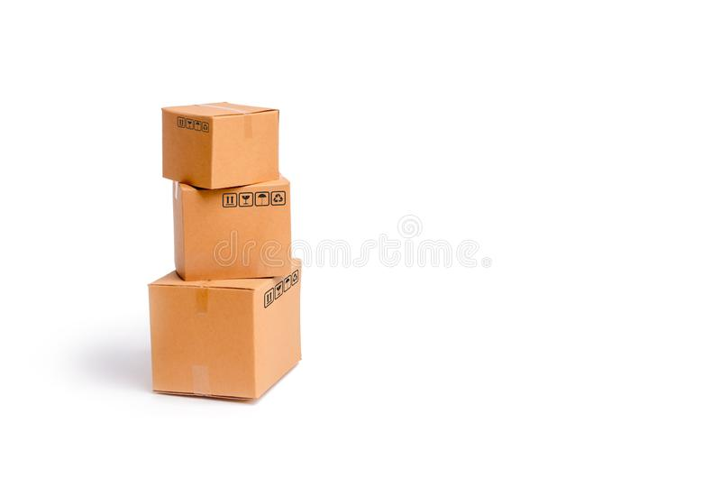 Cardboard boxes on a white background. The concept of packing goods, sending orders to customers. Warehouse of finished products. And equipment. Moving to stock image