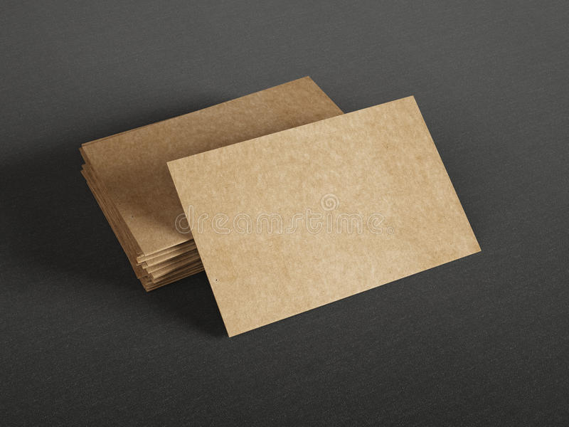 Cardboard business cards on dark background royalty free stock photos
