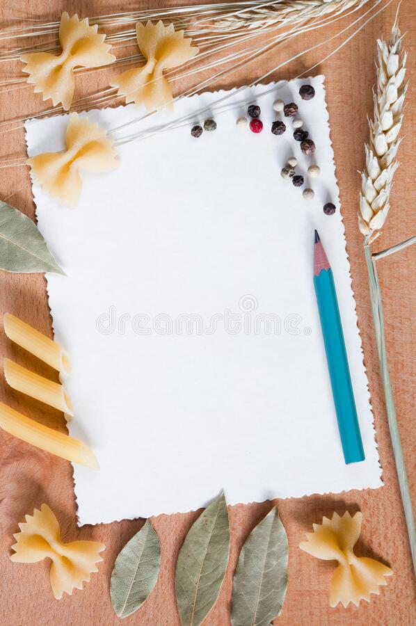 Cardboard card with decorative frame of pasta and spices stock photo