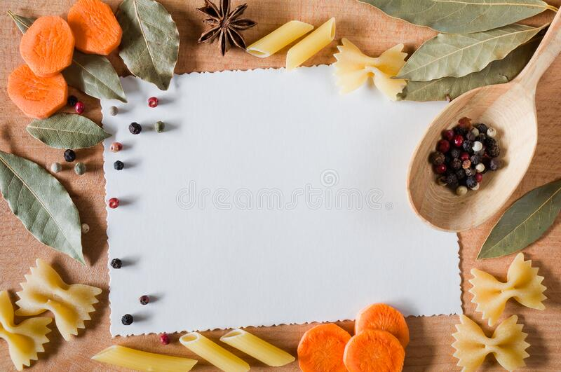 Cardboard card with decorative frame of pasta and spices stock image