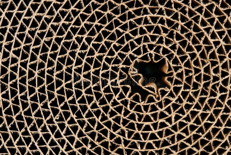 Cardboard circle. Webbed circle made of brown cardboard, horizontal stock photography