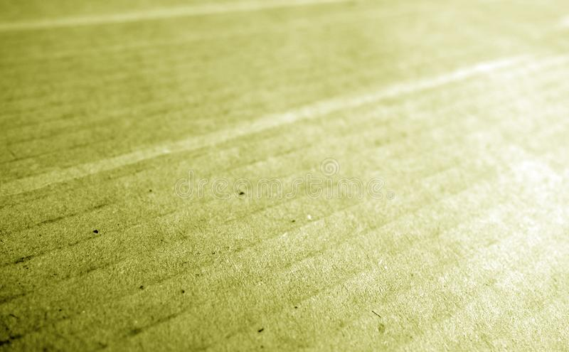 Cardboard close-up with blur effect in yellow tone royalty free stock photography
