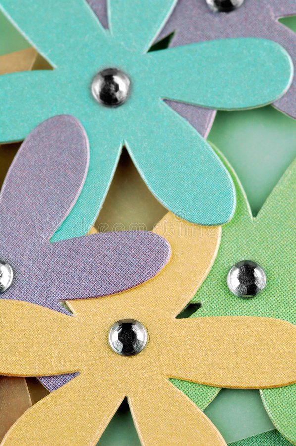 Cardboard daisies. Colorful cut-out cardboard daisies used for craftwork hobbies royalty free stock photos