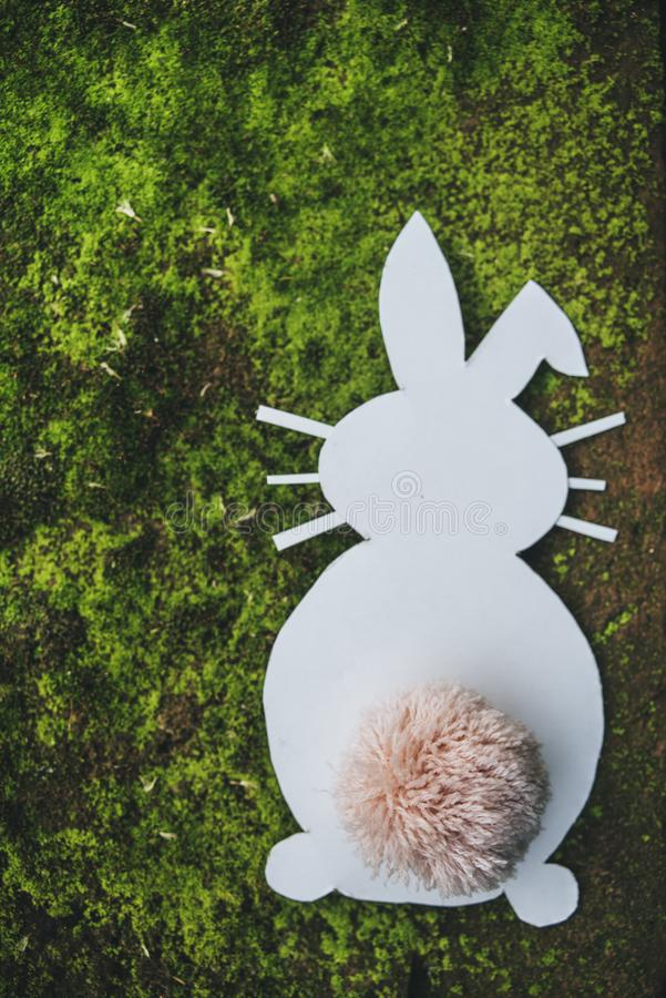 Cardboard Easter bunny on green background royalty free stock images
