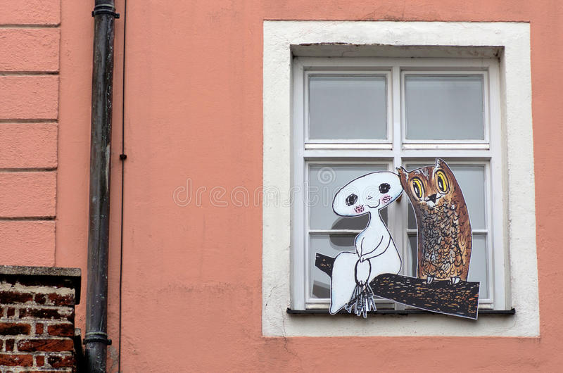 Cardboard figures. Cardboard life size figures of an owl and white ghost staying by the window of a house. Fairy tale characters stock image