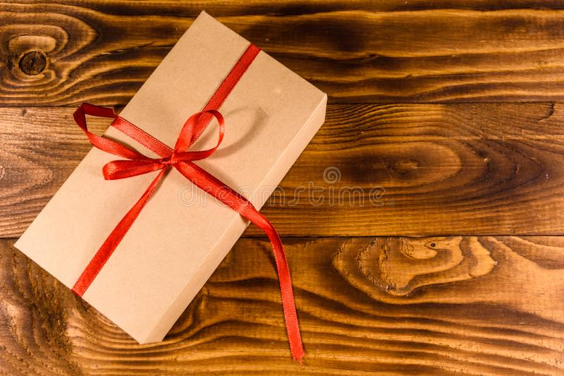 Cardboard gift box on a wooden table. Top view. Cardboard gift box on rustic wooden table. Top view stock photography