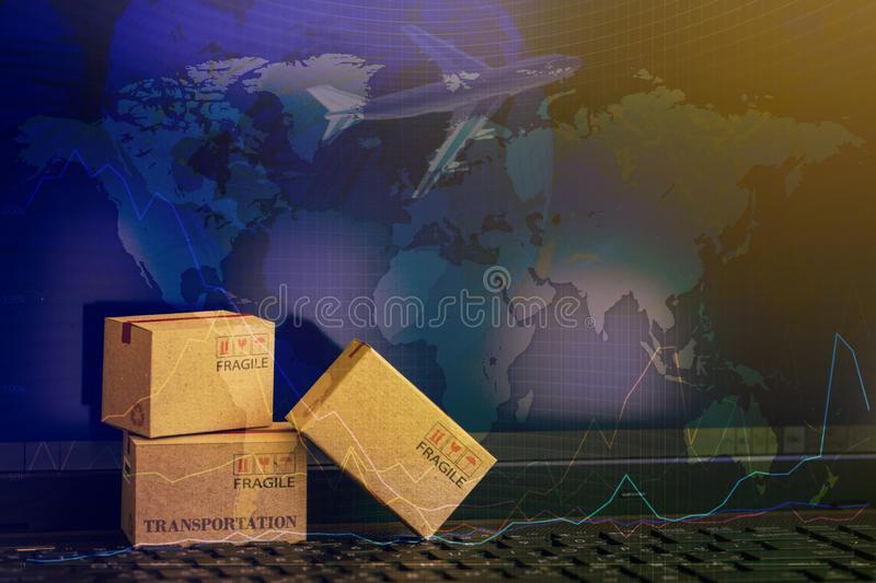 Cardboard paper boxes on notebook with a plane flies behind.business concept of International freight or shipping service for stock images