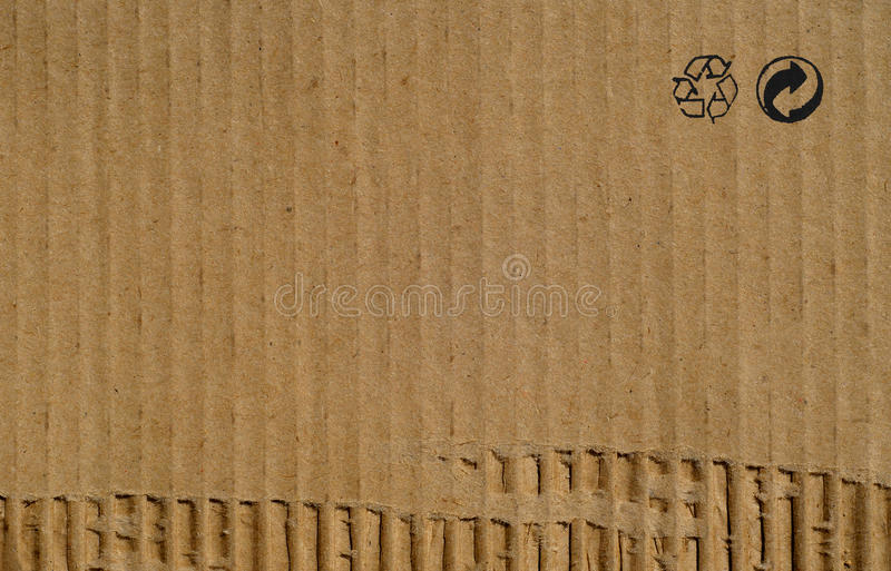 Cardboard paper texture background with recycling signs. Cardboard brown paper texture background with recycling signs royalty free stock image
