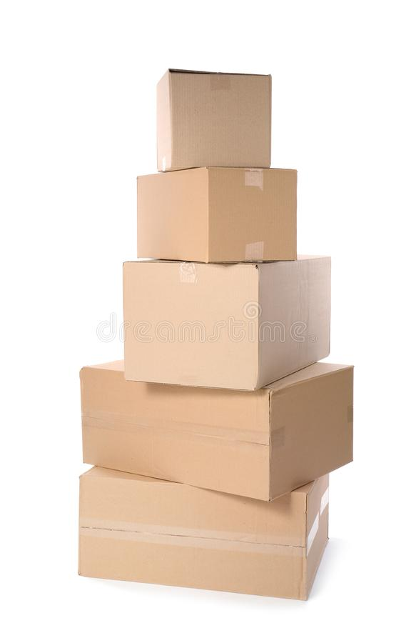 Cardboard parcel boxes on white background. Mockup for design royalty free stock photography