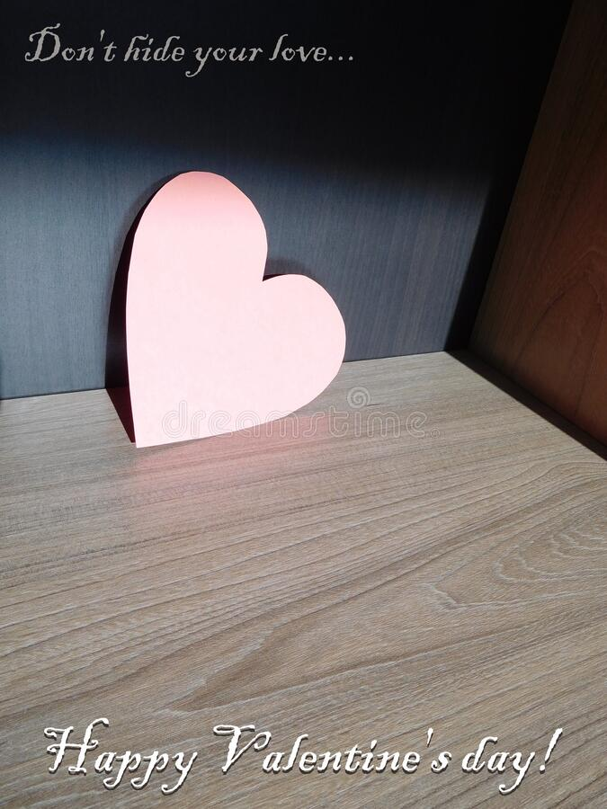Cardboard pink heart in a box for Valentine`s Day stock photo
