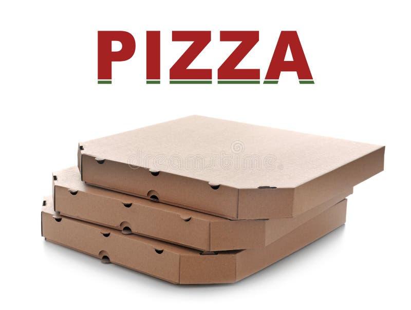 Cardboard pizza boxes on white background stock photos
